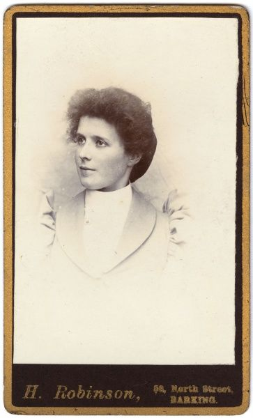 A young Victorian woman in a head and shoulders portrait. She is wearing a jacket with high puffed sleeves