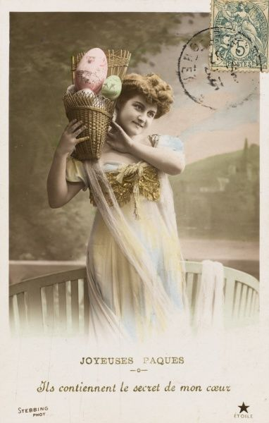 A young woman with a basket full of decorated Easter eggs -- 'These eggs hold the secret of my heart !&#39