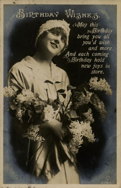Birthday Wishes -- a young woman (the actress Drina Verchesi) holding a bunch of lilac on a birthday postcard. Date: 1920