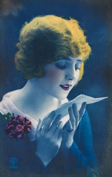 A striking postcard in vidid colours, depicting a pretty Yugoslavian Girl reading a love letter, possibly from a partner away fighting in a distant land