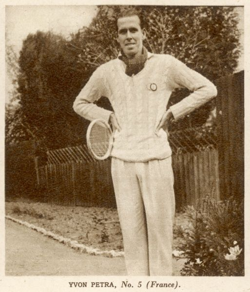 Yvon Petra(1916-1984), French tennis player, pictured here posing in his tennis whites, prior to winning the 1946 Wimbledon men's singles title