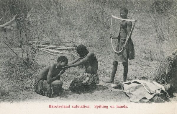 Zambia - Spitting on Hands as a form of traditional Greeting