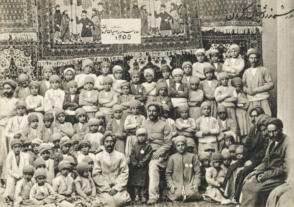 A superb postcard showing the pupils and teachers of a Zoroastrian School in Iran