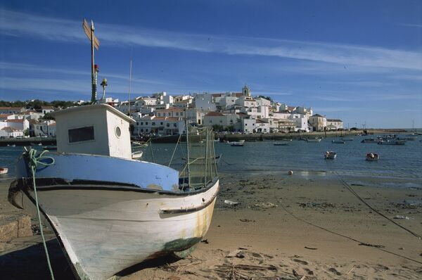 Fishing boat on the beach in small fishing village near Portimao