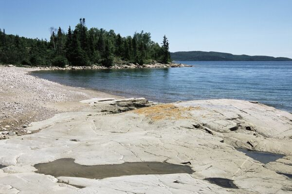 North shore of lake on rocky platform of forested Laurentian ...