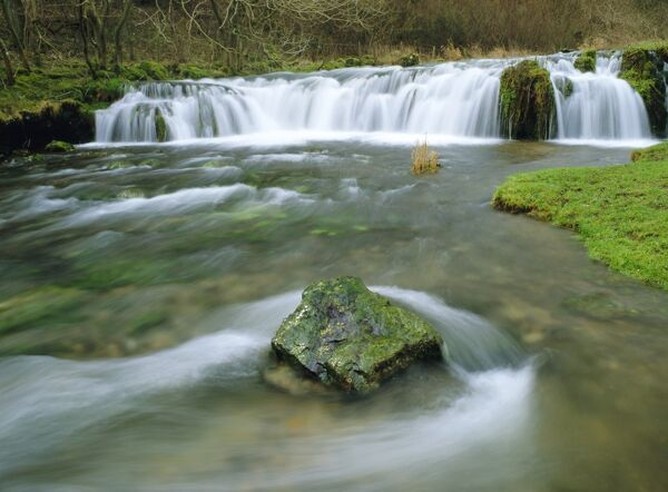 Waterfall on River Lathkill, Lathkill Dale, Peak District National Park, Bakewell, Derbyshire, England
