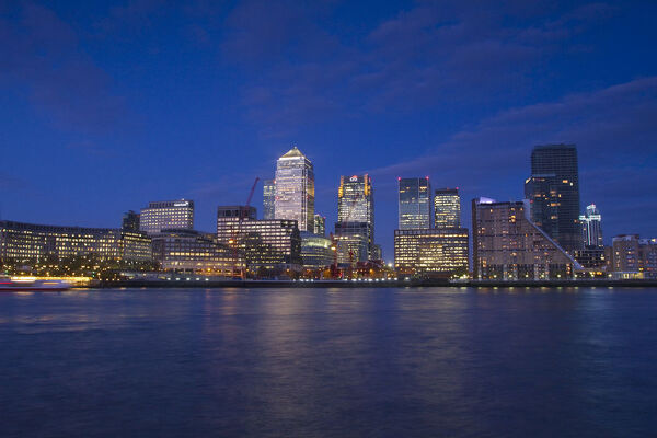 England, London, Docklands, Canary Wharf viewed across River Thames at twilight