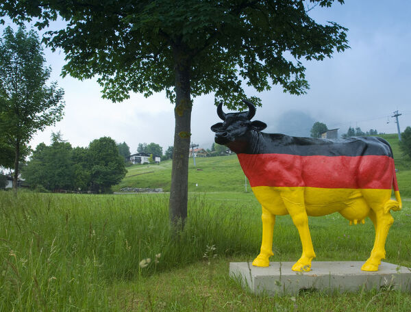 Germany, Bavaria (Bayern), cow statue painted in German flag