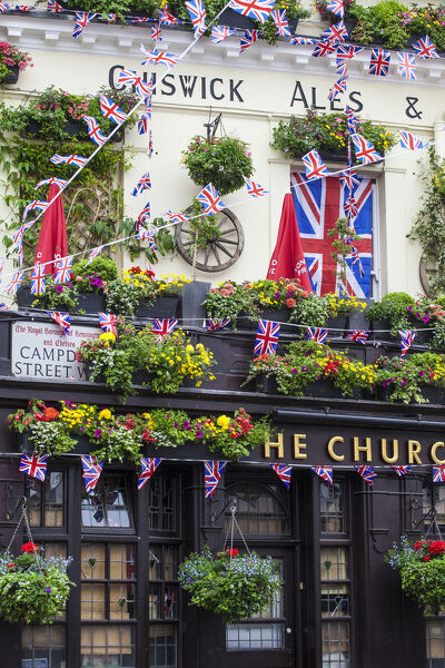 UK, England, London, Kensington, The Churchill Arms Pub with Union Jack bunting to celebrate the Queens Diamond Jubillee