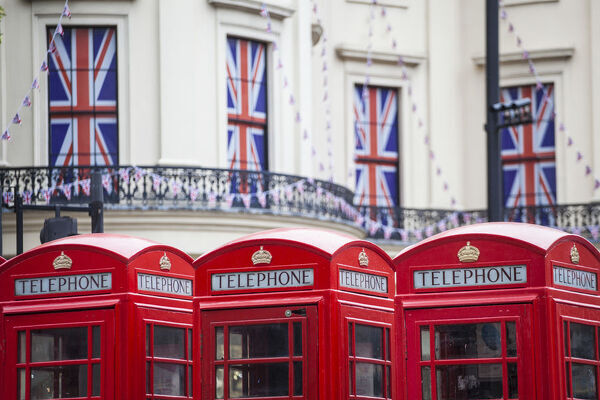 UK, England, London, The Strand, Red telephone box and Union Jack bunting to celebrate the Queens Diamond Jubillee