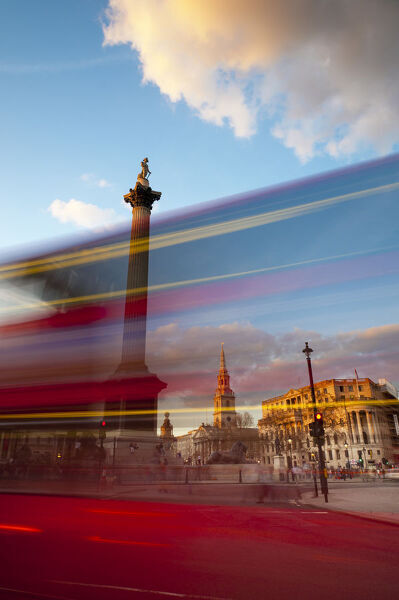 UK, London, Trafalgar Square, Nelson's Column and blurred bus