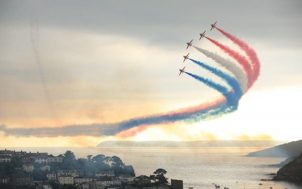 The Red Arrows fly in formation over fowey harbour for annual regatta