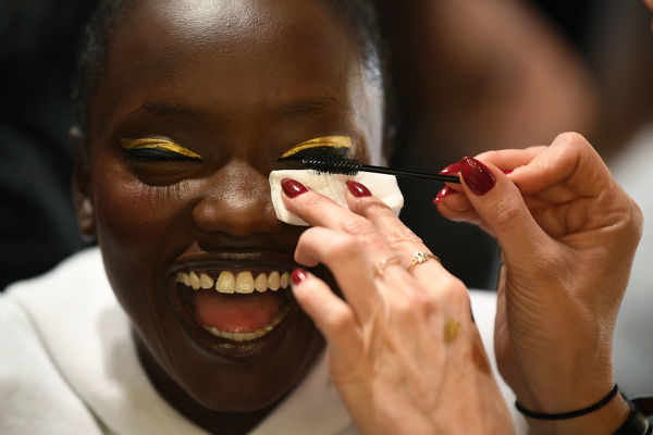 Models are seen preparing backstage ahead of the Carla Zampatti show during Mercedes-Benz Fashion Week Australia in Sydney, Thursday, May 16, 2019. (AAP Image/Joel Carrett) NO ARCHIVING, EDITORIAL USE ONLY