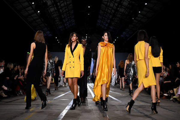 Models walk the runway wearing creations by Carla Zampatti during Mercedes-Benz Fashion Week Australia in Sydney, Thursday, May 16, 2019. (AAP Image/Dan Himbrechts) NO ARCHIVING, EDITORIAL USE ONLY
