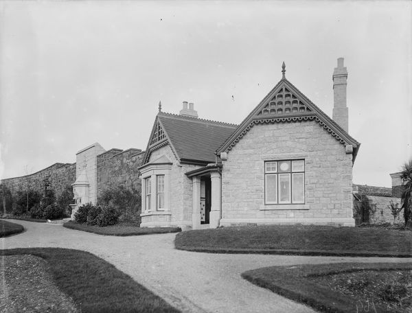 A view of the Gardener's house in Victoria Gardens. Victoria Gardens were created to commemorate the Diamond Jubilee of Queen Victoria in 1897. Photographer: Arthur William Jordan