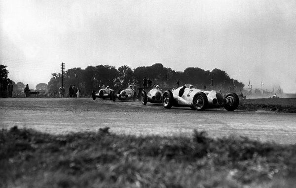 1937 Donington Grand Prix.  Donington Park, Great Britain.  2 October 1937.  Hermann Lang leads Rudolf Caracciola, Dick Seaman (all Mercedes-Benz W125) and Bernd Rosemeyer (Auto Union C-typ). Rosemeyer, von Brauchitsch and Caracciola finished in 1st
