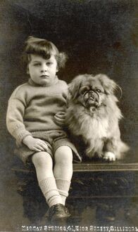 CHILD AND PEKINGESE