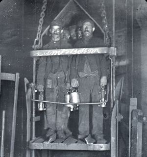 Coal miners in shaft lift, South Wales