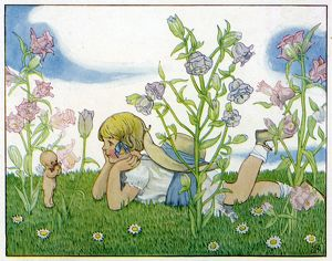Girl with a baby fairy lying in the garden in summer