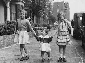Three sisters walking down the street