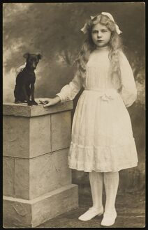 YOUNG GIRL AND PET DOG