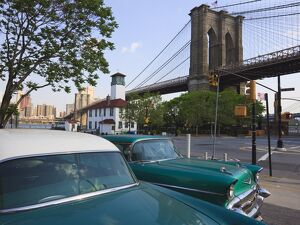 Two 1950's cars parked near the Brooklyn Bridge at Fulton Ferry Landing