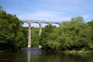 Barge and pedestrians on the Pontcysyllte Aqueduct, UNESCO World Heritage Site