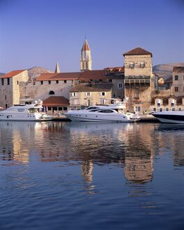 Boats moored in front of the Old Town, Trogir, UNESCO World Heritage Site