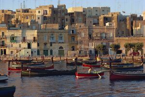 Boats moored in Valletta harbour at dusk