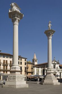 Two columns in the Piazza dei Signori, one bearing the Venice Lion, the other with St