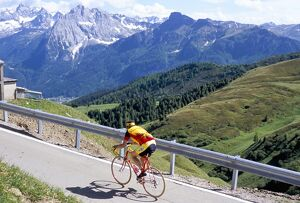 Cyclist riding over Sella Pass