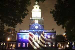Independence Hall illuminated at night with sound and light show in Philadelphia