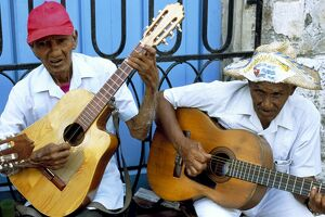 Musicians playing guitars, Havana Viejo, Havana, Cuba, West Indies, Central America