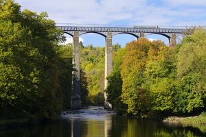 Narrowboat crossing the River Dee in autumn on the Pontcysyllte Aqueduct, built by Thomas Telford