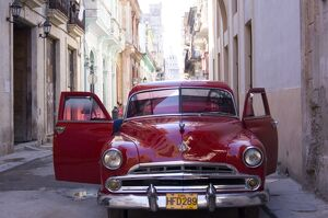 An old car in a small street in Habana Vieja (old town), Havana, Cuba, West Indies