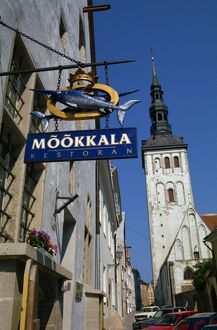 Sign for the Mookkala Restaurant with the Niguliste Church behind, Old Town