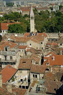 Skyline of houses with tile roofs and Diocletian's palace in old town