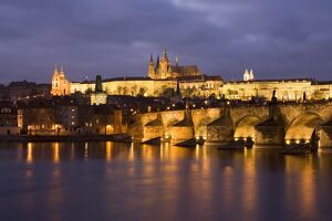 St. Vitus Cathedral, Charles Bridge and the Castle District illuminated at night in winter