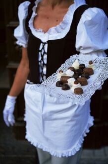Waitress carrying tray of chocolate