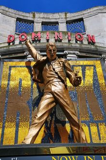 Statue of Freddie Mercury outside We Will Rock You at the Dominion Theatre, London, England