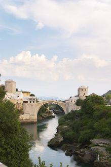 View along the river of the old reconstructed bridge. Historic town of Mostar. Federation