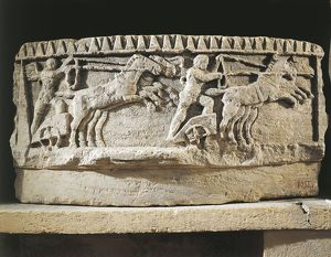 Architectural fragment representing a winged genius guiding a chariot on the circus racecourse
