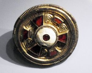 jewelled disc brooch in gilt, silver and garnet. Found Chatham Lines, Kent, England