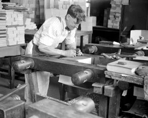 At Messrs James Burns' Book Binding works at Esher. Gilding the edge. 15 May 1923