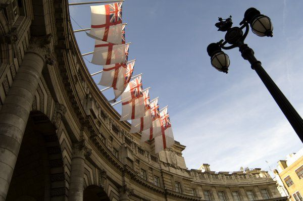 ADMIRALTY ARCH, The Mall, City of Westminster, London. An oblique view including the arch, White Ensign flags and street lamp