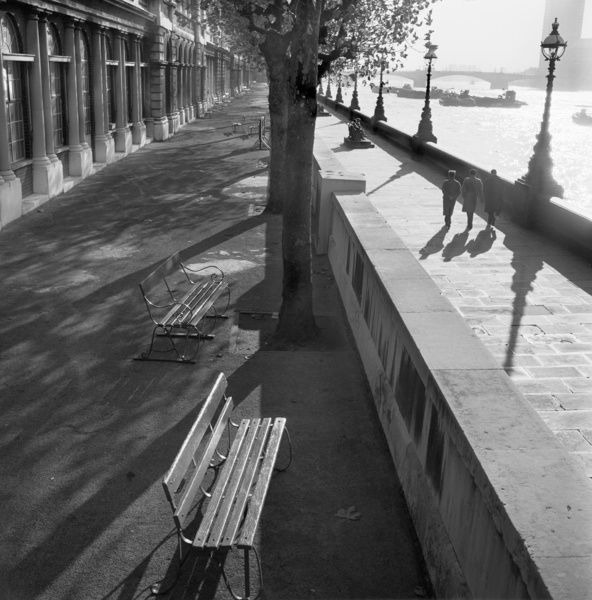 ALBERT EMBANKMENT, London. View towards Lambeth Bridge and the Millbank Tower. Bench in the foreground with people walking by the river Thames. Photographed by John Gay. Date range: 1960-1963