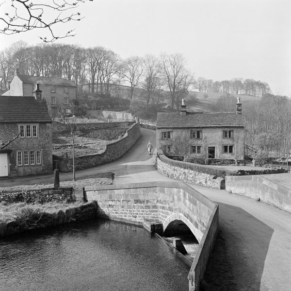 ALPORT, Derbyshire. A single span stone bridge carries the road over the River Lathkill. Photographed by John Gay in 1959