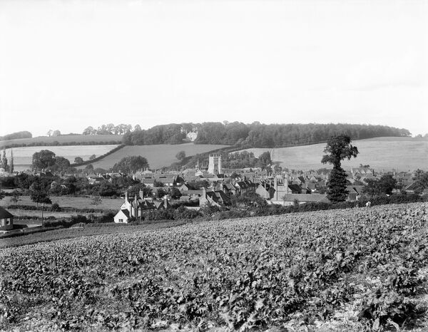 AMERSHAM, Buckinghamshire. A view of the town, lying in the valley of the Misbourne, showing the tower of St Mary's Church. In 1892, the railway arrived and the town buildings spread towards the new station on the hill. Photographed by Henry Taunt