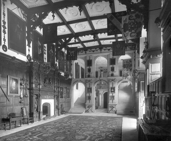 AUDLEY END HOUSE, Saffron Walden, Essex. Interior view of the Great Hall looking towards the stone screen and great staircase. The House was built on a palatial scale by Thomas Howard, first Earl of Suffolk and Lord Treasurer to James I, between 1605 and 1614