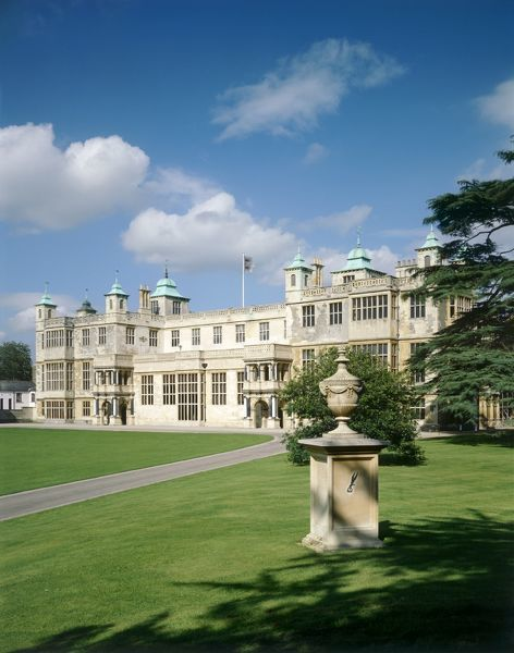 AUDLEY END HOUSE AND GARDENS, Essex. General view of the front of the house with memorial urn in foreground. Sunny day